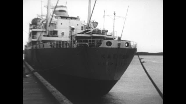 Canadian National Railroad cars off loading bulk grain into oceangoing ships