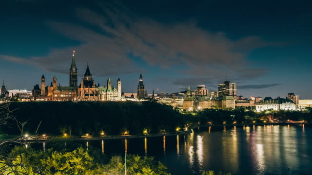 canadian parliament on ottawa river with fireworks - ottawa stock videos & royalty-free footage