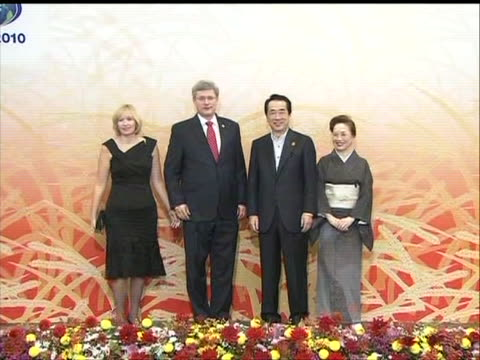 canadian prime minister stephen harper and his wife, laureen, are greeted by japan prime minister naoto kan and his wife, nobuko, at the 2010 apec... - (war or terrorism or election or government or illness or news event or speech or politics or politician or conflict or military or extreme weather or business or economy) and not usa stock videos & royalty-free footage