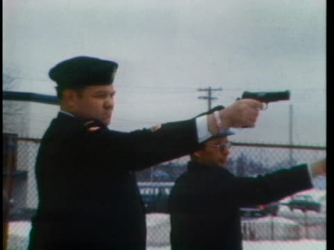 canadian soldiers fire pistols during target practice. - (war or terrorism or election or government or illness or news event or speech or politics or politician or conflict or military or extreme weather or business or economy) and not usa stock videos & royalty-free footage