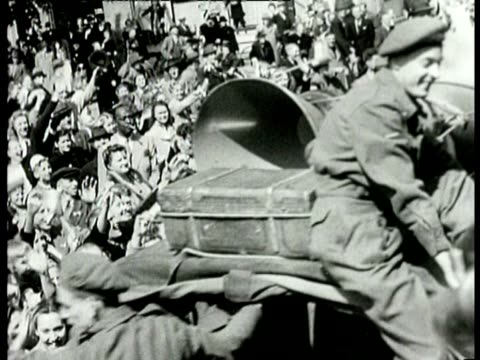 canadian soldiers in jeeps drive through the streets of a city and they are cheered on by an ecstatic crowd - 1945 stock videos & royalty-free footage
