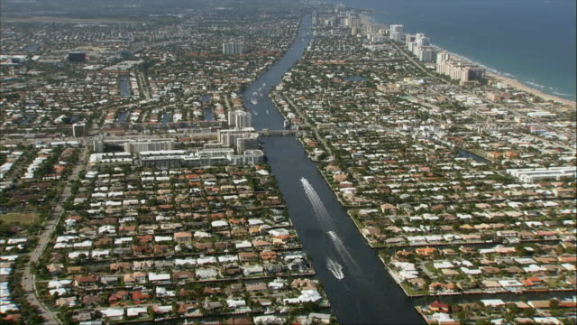 AERIAL, Canal and coastline, Miami, Florida, USA