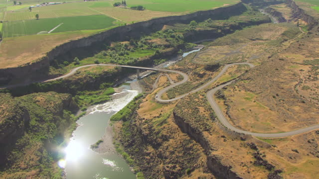 ws aerial canal and green fields with low water level in snake river valley / idaho, united states - river snake stock videos & royalty-free footage