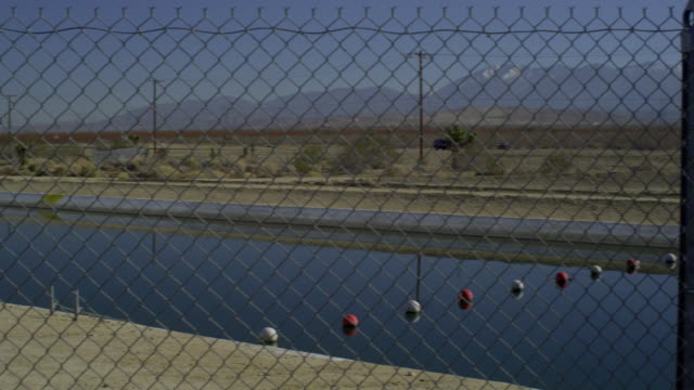 ms pan ws canal and highway with hills in background, palmdale, california, usa - palmdale stock videos and b-roll footage