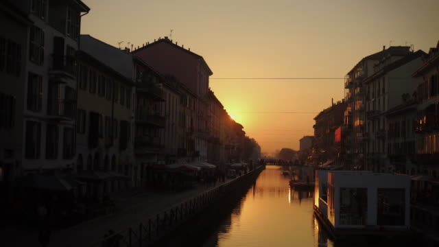 canal at naviglio grande in milan, italy at sunset - milano video stock e b–roll