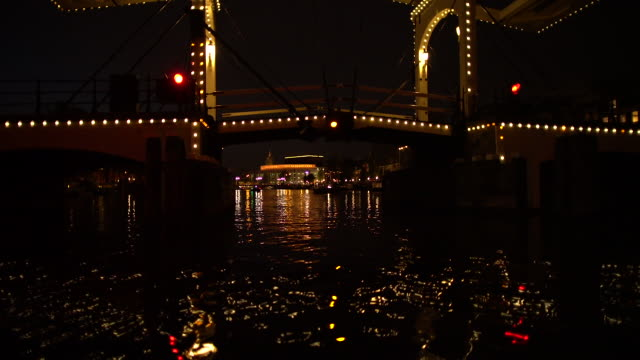 canal at night- draw bridge - boat point of view stock videos & royalty-free footage