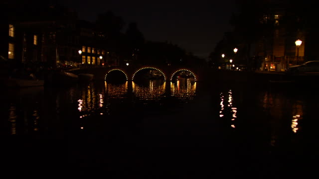 canal at night-going under bridge - boat point of view stock videos & royalty-free footage