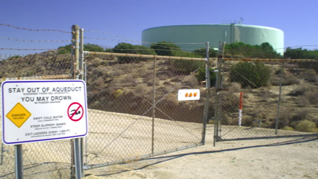 ms pan canal behind chain link fence, palmdale, california, usa - palmdale stock videos and b-roll footage