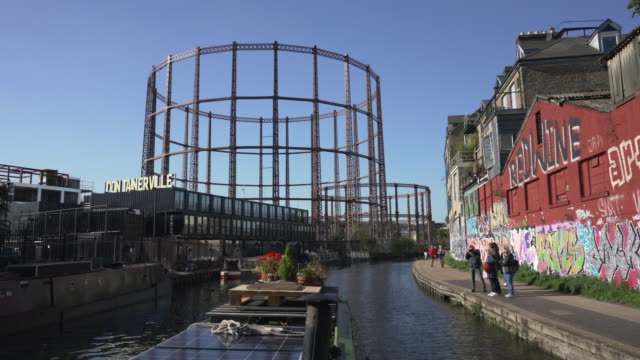 a canal boat travelling along the regent's canal in east london. - canal stock videos & royalty-free footage