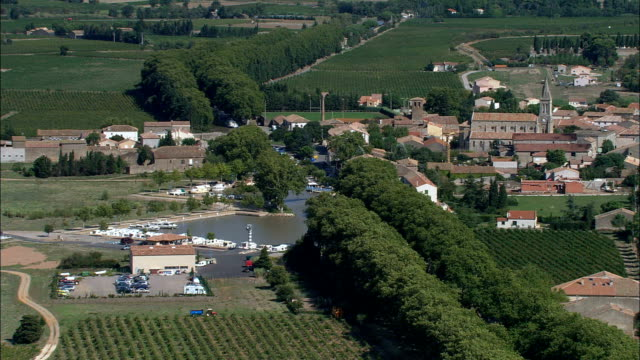 canal du midi by homps and homps and ognon locks  - aerial view - languedoc-roussillon, aude, arrondissement de narbonne, france - aude stock videos & royalty-free footage