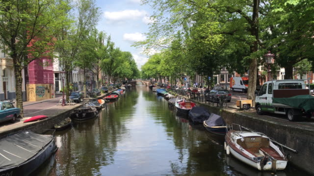 canal in amsterdam on a sunny summer day - canal stock videos & royalty-free footage