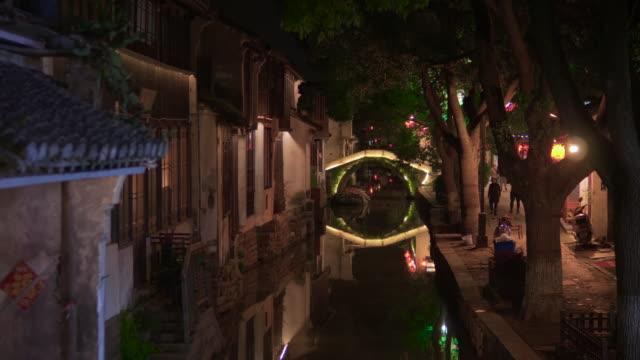 ws zi canal in old chinese town at night, zhouzhuang, kunshan, jiangsu province, china - arch bridge stock videos & royalty-free footage