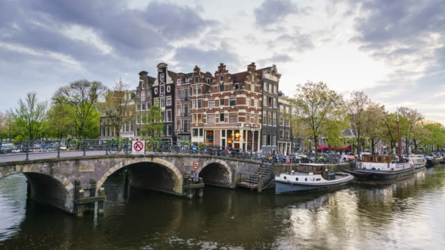 canal scene in amsterdam, time lapse - arch bridge stock videos and b-roll footage