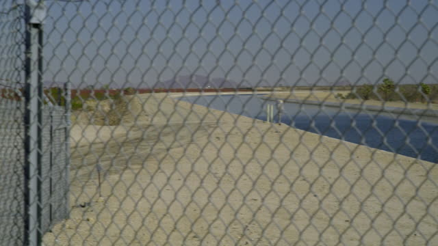 ms pan canal seen through chain link fence, palmdale, california, usa - palmdale stock videos and b-roll footage