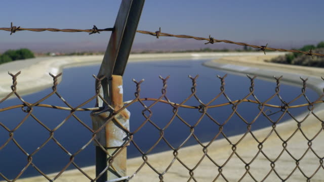 cu canal seen through chain link fence, palmdale, california, usa - palmdale stock videos and b-roll footage