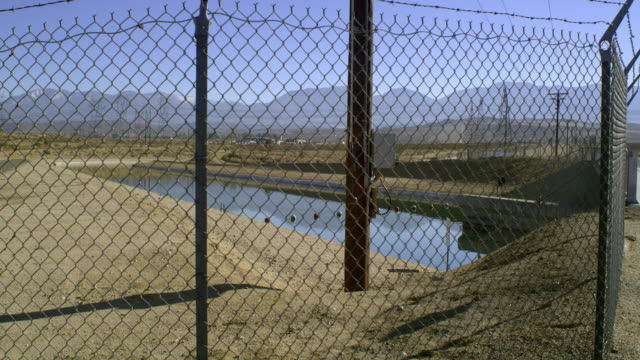 ms canal seen through chain link fence, palmdale, california, usa - palmdale stock videos and b-roll footage