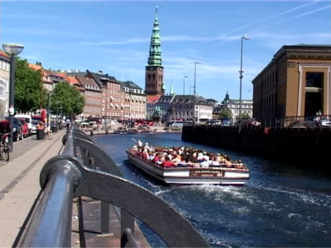 canal tour boat in copenhagen - denmark - exploration stock videos & royalty-free footage