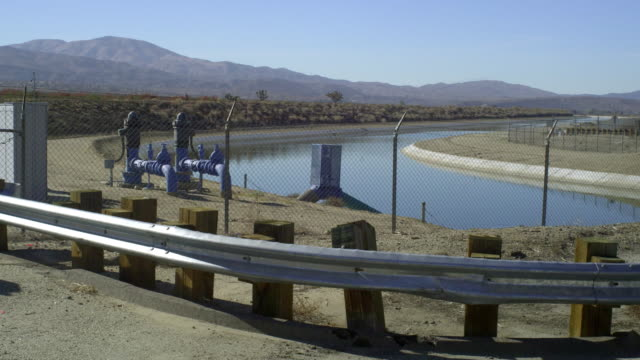 ms canal with hills in background, palmdale, california, usa - palmdale stock videos and b-roll footage