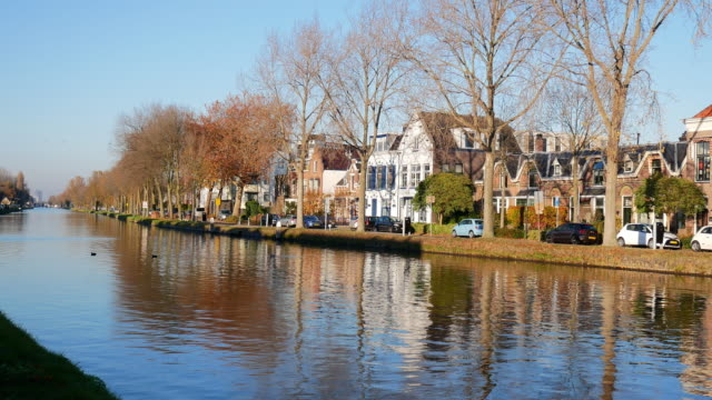 canals and urban scene in dutch town delft, south holland province, in autumn on sunny day - the hague stock videos and b-roll footage