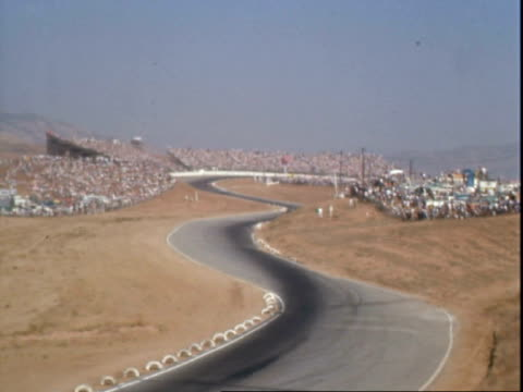 canam race cars racing along esses at riverside international raceway / 1965 pontiac grand prix pace car driving along racetrack / race car driver... - pontiac stock videos and b-roll footage