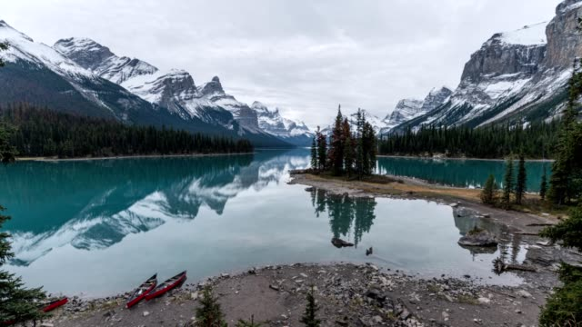 cananadian rockies on maligne lake with tourists and canoe at spirit island, jasper national park - maligne river stock videos & royalty-free footage