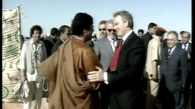 victims speak out lib libya nr tripoli photography** tony blair mp along to shake hands with libyan leader colonel moammar gaddafi general views of... - libya stock videos & royalty-free footage