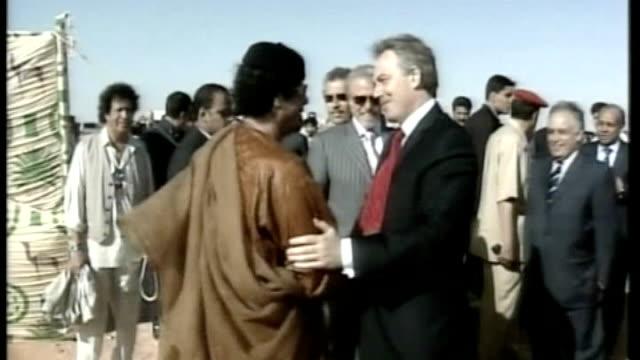 victims speak out lib libya nr tripoli photography** tony blair mp along to shake hands with libyan leader colonel moammar gaddafi general views of... - muammar gaddafi stock videos & royalty-free footage