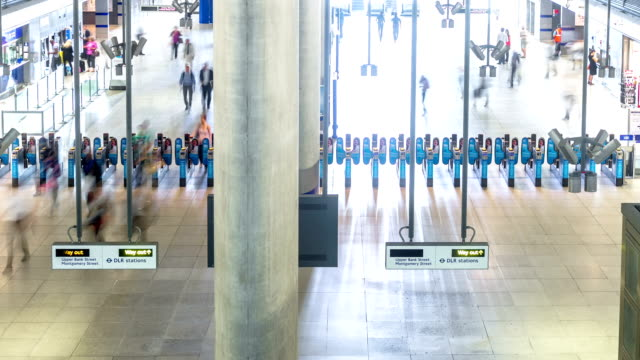 canary wharf station timelapse medium shot ticket barriers - entrance sign stock videos & royalty-free footage