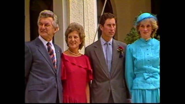 stockvideo's en b-roll-footage met prince charles and princess diana out of raaf plane and down steps greet officials –cold windy conditions – governor general sir ninian stephen and... - 1983