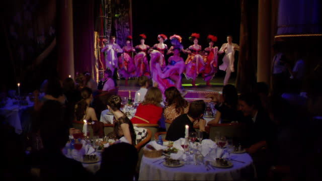 Can-can dancers perform in a cabaret show.