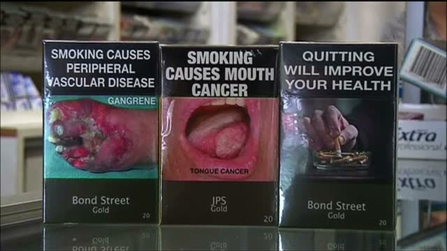 A cancer charity is demanding Britain follow Australia's lead by banning advertising on cigarette packets Australia's ban comes into force today with...