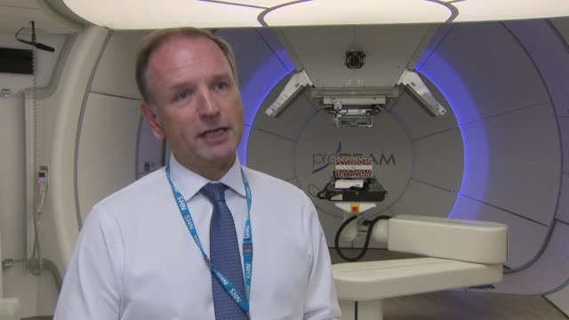 nhs england simon stevens at proton beam therapy centre christie hospital england manchester the christie hospital int simon stevens interview re new... - proton stock videos and b-roll footage