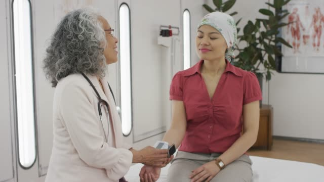 cancer patient having her blood pressure checked - pacific islander doctor stock videos & royalty-free footage