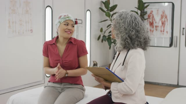 Cancer Patient Having Lively Conversation With Her Senior Physician