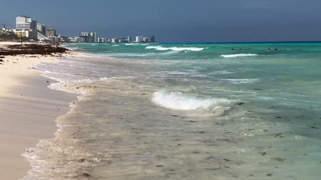 Cancun beach and people in the horizon