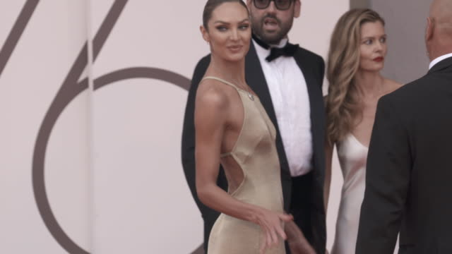 candice swanepoel at 'the truth ' - red carpet arrivals - 76th venice film festival august 28, 2019 in venice, italy. - べネチア国際映画祭点の映像素材/bロール