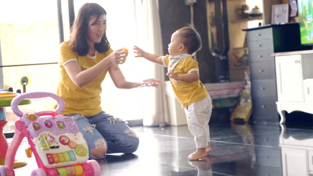 candid : mother & baby playing at home - candid stock videos & royalty-free footage