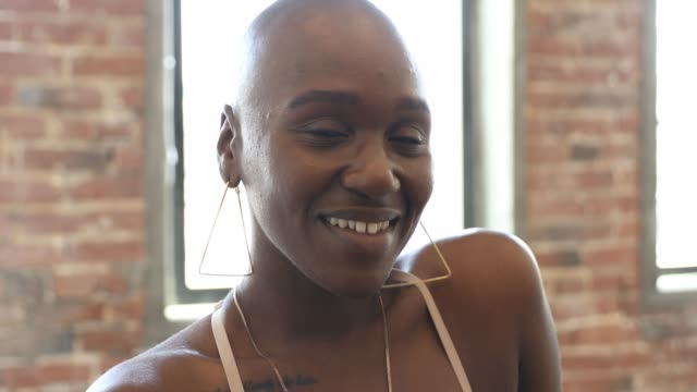 candid portrait of cute afro american woman at home - completely bald stock videos & royalty-free footage