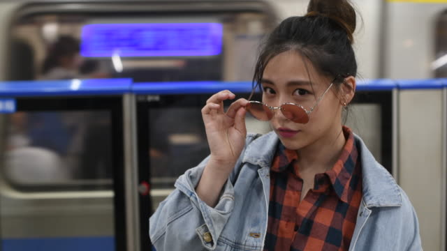 candid portrait young woman on a subway station - taipei stock videos & royalty-free footage