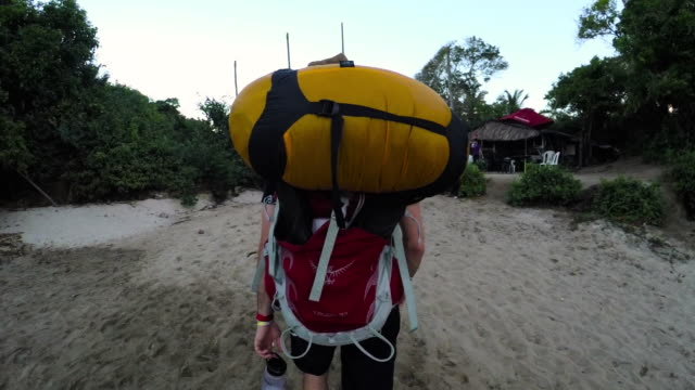 Candid shot of an unrecognizable caucasian male hiking the Amazon Rainforest