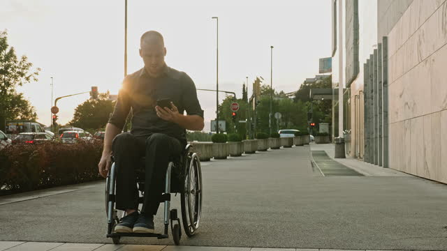 candid video of businessman in wheelchair rolling to work - wheelchair stock videos & royalty-free footage