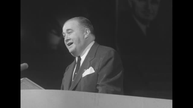 candidate for nomination governor adlai stevenson standing at rostrum in convention hall waiting to speak and waving at cheering delegates / dever... - adlai stevenson ii stock videos and b-roll footage