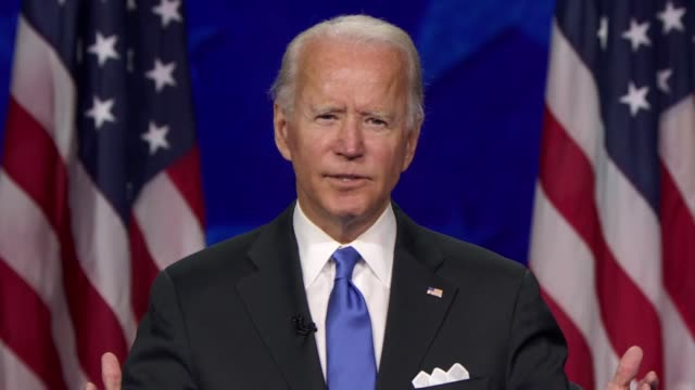 2020 candidate for president joe biden says in his nomination acceptance speech that climate change must be dealt with not only a crisis but an... - paying taxes stock videos & royalty-free footage