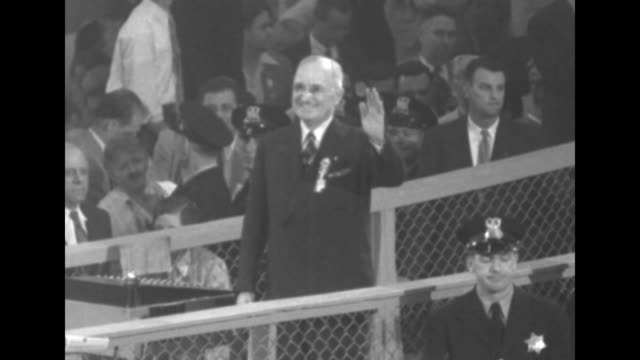 candidate governor adlai stevenson on podium with indiana governor henry schricker delegates crowd the floor below some clapping and cheering /... - adlai stevenson ii stock videos and b-roll footage