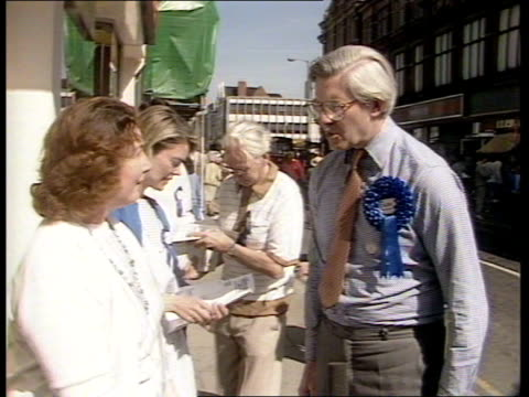 candidates canvass before the stafford byelection england stafford ts people along high street ts car along with loud speakers on it tms bill rodgers... - stafford england stock videos and b-roll footage
