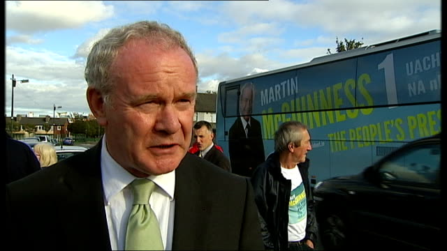 candidates for the irish presidency; ext mcguinness signing autograph long shot local men watching from outbuilding martin mcguinness interview sot -... - hand on heart stock videos & royalty-free footage