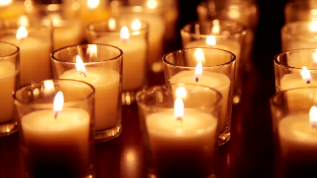 candle background - votive candle stock videos and b-roll footage