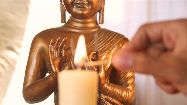 cu tu slo mo candle being lit up with buddha figure / miami, florida, united states - buddha stock videos & royalty-free footage