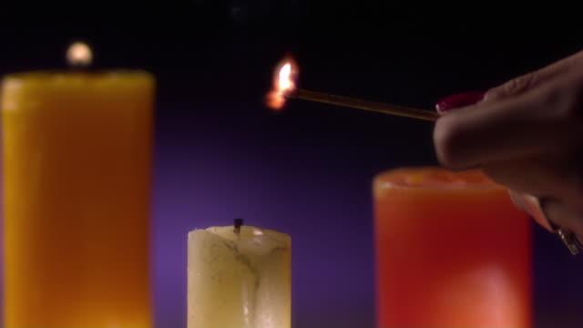vídeos y material grabado en eventos de stock de a candle being lit - esmalte de uñas rojo