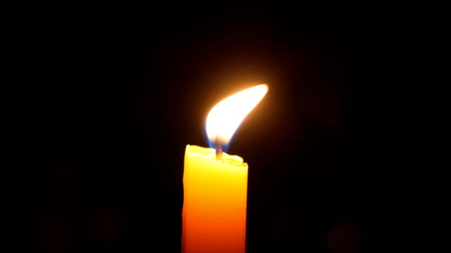 candle burning black background - candlelight stock videos & royalty-free footage